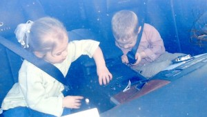 Twins Kelsey and Ethan fasten seat belts in Alex's demonstrator Infiniti May 2006