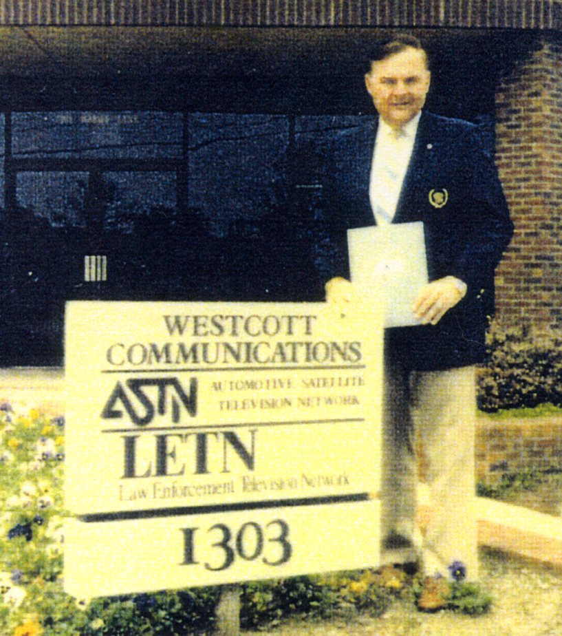Alex by the ASTN sign at ASTN headquarters to tape his series of programs
