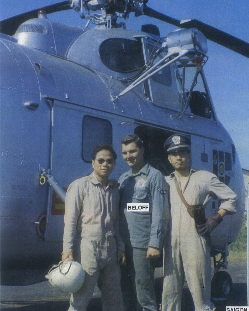 Alex with his two Vietnamese helicopter pilots (1961) who took Alex and his tool box to various, CRYPTO, TACAN, GCA and radar sites in Vietnam and Laos forward areas